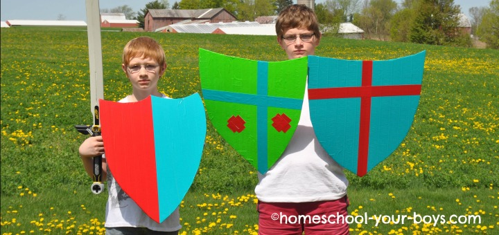 boys holding Kite Shields