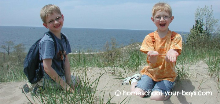 boys posing on sand dune by Lake Michigan