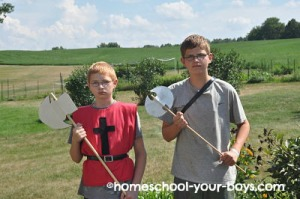 boys holding battle axes