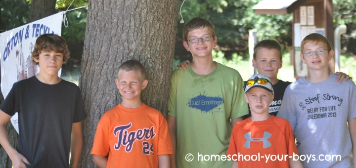 preteen boys smiling at camera