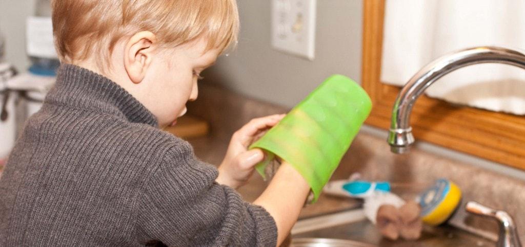 boy washing a glass
