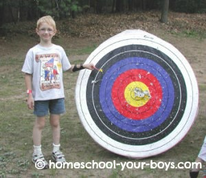 cub scout by arrow target