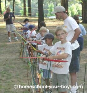 cub scouts shooting bow and arrows