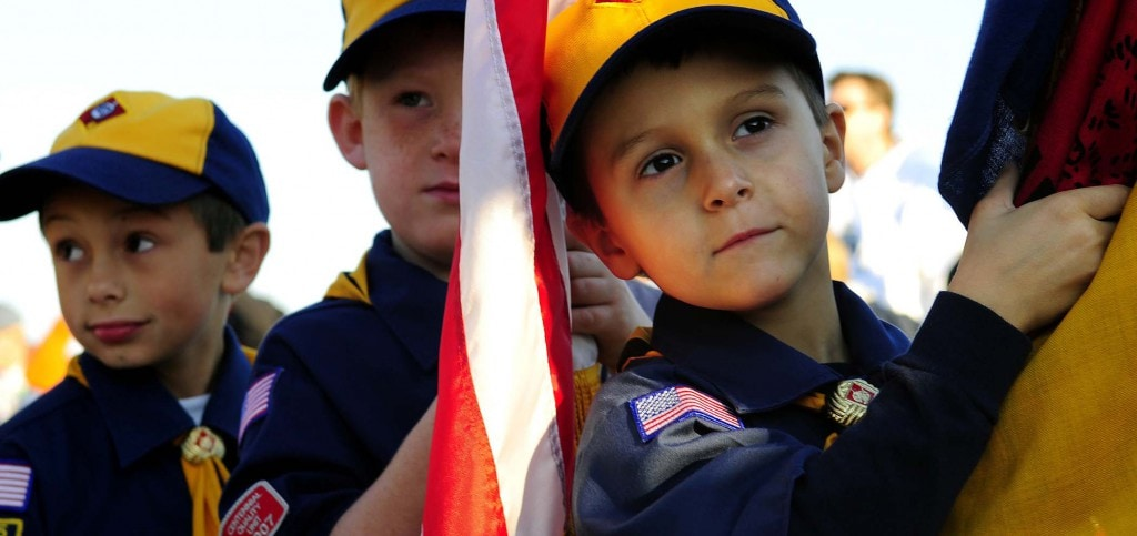 cub scouts doing a flag salute