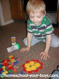 boy using pattern blocks