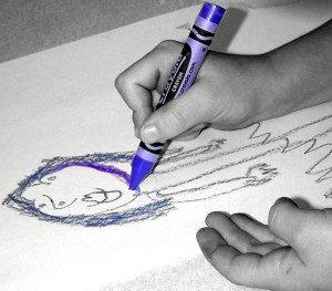 Child drawing a picture of a person