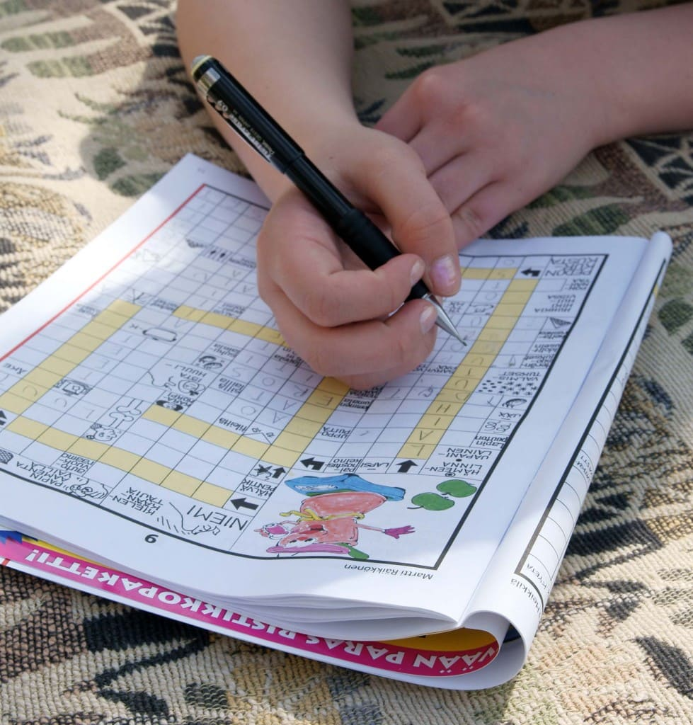 Child filling out a crossword puzzle