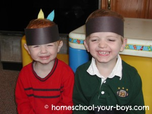 Preschool boys with Indian headbands