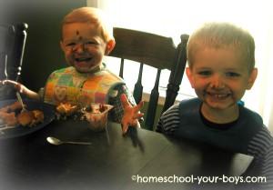 boys eating pudding